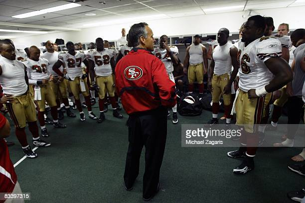 Head coach Mike Nolan of the San Francisco 49ers addresses the team for the final time after the NFL game against the New York Giants on October 19...