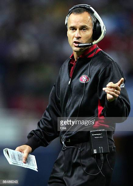 Head coach Mike Nolan of the San Francisco 49ers directs his players in the first half against the St Louis Rams on December 24 2005 at the the...