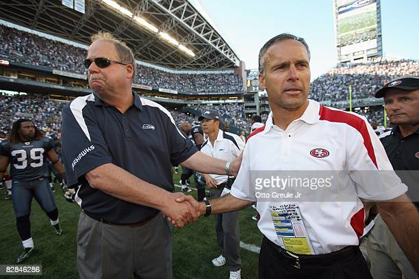 Head coach Mike Nolan of the San Francisco 49ers is congratulated by head coach Mike Holmgren of the Seattle Seahawks after the 49ers defeated the...