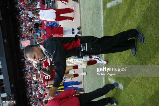 Head Coach Mike Nolan of the San Francisco 49ers makes calls during the game against the Arizona Cardinals at Monster Park on December 4th 2005 in...