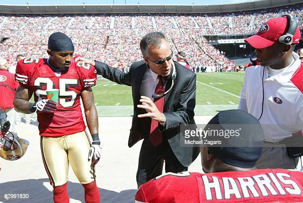 Head coach Mike Nolan of the San Francisco 49ers meets with cornerback Tarell Brown during the NFL game against the Detroit Lions on Bill Walsh Field...