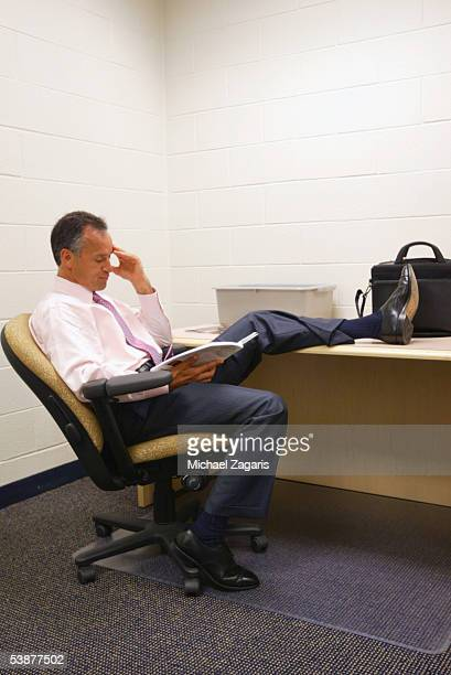 Head Coach Mike Nolan of the San Francisco 49ers preps in the locker room before the game against the Denver Broncos at Invesco Field at Mile High on...