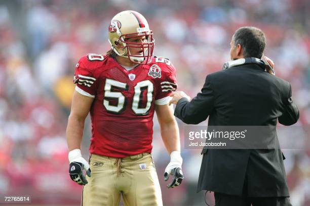Head coach Mike Nolan of the San Francisco 49ers talks to linebacker Derek Smith against the Seattle Seahawks at Monster Park on November 19 2006 in...