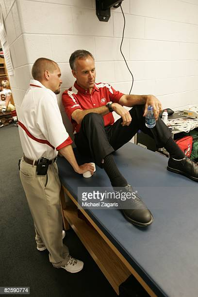 Head Coach Mike Nolan of the San Francisco 49ers talks with Jeff Ferguson in the locker room before the NFL game against the Chicago Bears at Soldier...