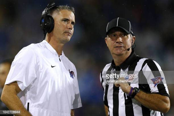 Head coach Mike Norvell of the Memphis Tigers talks to an official during the first half against the Tulane Green Wave at Yulman Stadium on September...
