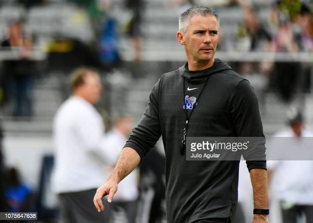 head coach Mike Norvell of the Memphis Tigers walks across the field during warmup before the American Athletic Championship against the UCF Knights...