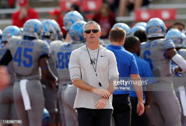 Head coach Mike Norvell of the Memphis Tigers watches players warm up before the game against the Houston Cougars at TDECU Stadium on November 16...