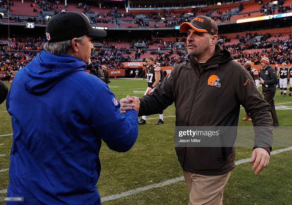 Head coach Mike Pettine of the Cleveland Browns congratulates head coach Chuck Pagano of the Indianapolis Colts after Indianapolis' 25-24 win at FirstEnergy Stadium on December 7, 2014 in Cleveland, Ohio.