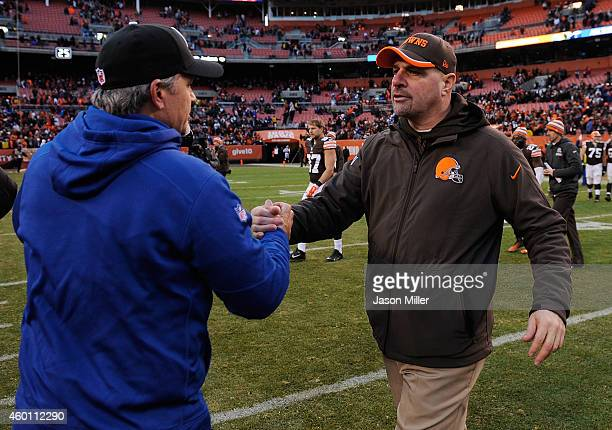 Head coach Mike Pettine of the Cleveland Browns congratulates head coach Chuck Pagano of the Indianapolis Colts after Indianapolis' 2524 win at...