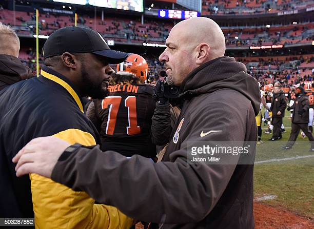 Head coach Mike Pettine of the Cleveland Browns congratulates head coach Mike Tomlin of the Pittsburgh Steelers after Pittsburgh's 2812 win at...