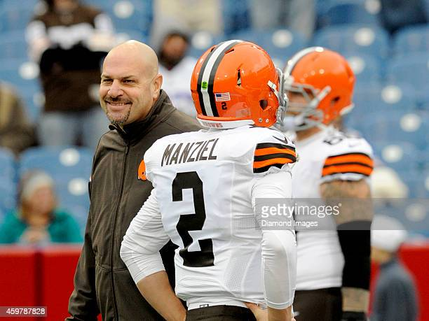 Head coach Mike Pettine of the Cleveland Browns shares a laugh with quarterback Johnny Manziel prior to a game against the Buffalo Bills on November...