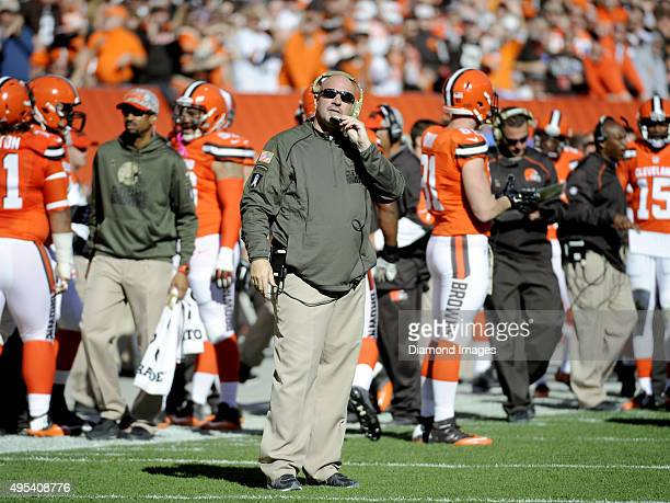 Head coach Mike Pettine of the Cleveland Browns watches a replay on the scoreboard during a game against the Arizona Cardinals on November 1 2015 at...