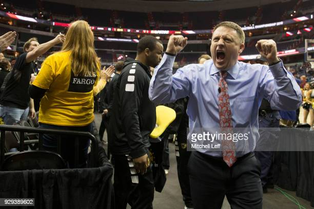 Head coach Mike Rhoades of the Virginia Commonwealth Rams celebrates as he walks off the court against the Dayton Flyers in the second round of the...