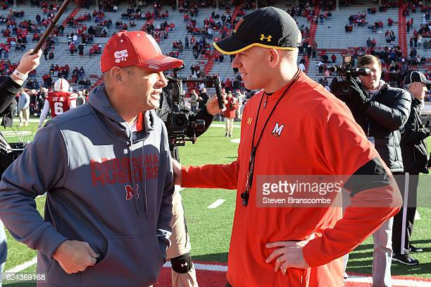 Head coach Mike Riley of the Nebraska Cornhuskers and head coach DJ Durkin of the Maryland Terrapins meet before the game at Memorial Stadium on...
