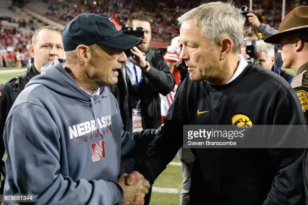 Head coach Mike Riley of the Nebraska Cornhuskers and head coach Kirk Ferentz of the Iowa Hawkeyes meet after the game at Memorial Stadium on...