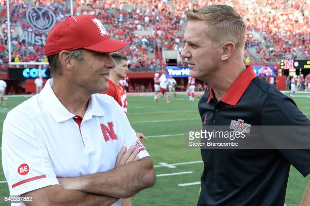 Head coach Mike Riley of the Nebraska Cornhuskers and head coach Blake Anderson of the Arkansas State Red Wolves meet before the game at Memorial...