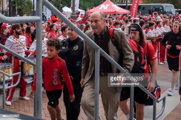 Head coach Mike Riley of the Nebraska Cornhuskers arrives at the stadium with the team before the game against the Ohio State Buckeyes at Memorial...