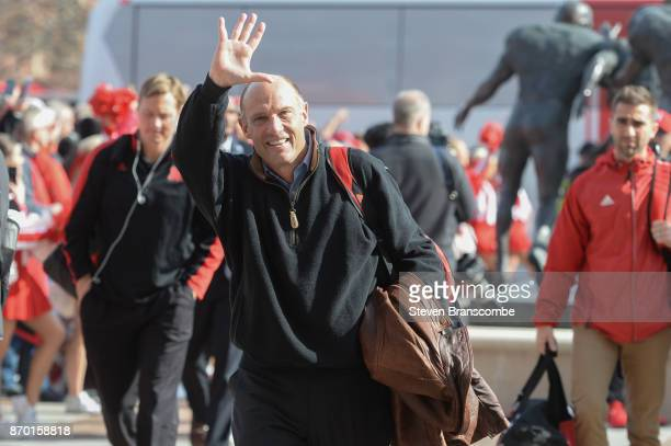 Head coach Mike Riley of the Nebraska Cornhuskers greets fans before the game against the Northwestern Wildcats at Memorial Stadium on November 4...