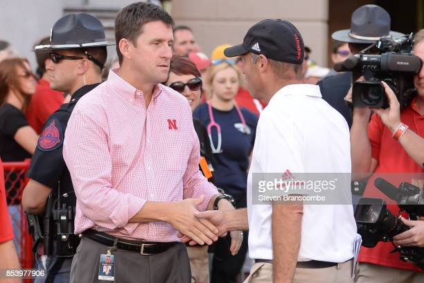 Head coach Mike Riley of the Nebraska Cornhuskers greets University of Nebraska President Hank Bounds after the game against the Rutgers Scarlet...