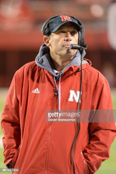 Head coach Mike Riley of the Nebraska Cornhuskers looks at the clock in late game action against the Ohio State Buckeyes at Memorial Stadium on...