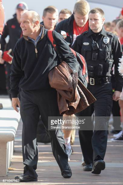 Head coach Mike Riley of the Nebraska Cornhuskers walks in with the team before the game against the Northwestern Wildcats at Memorial Stadium on...