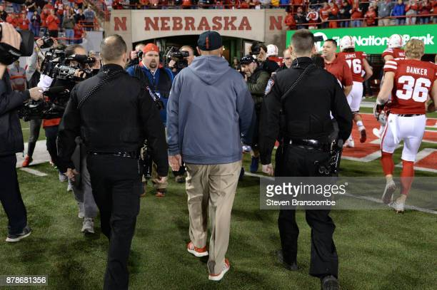 Head coach Mike Riley of the Nebraska Cornhuskers walks off the field after the game against the Iowa Hawkeyes at Memorial Stadium on November 24...