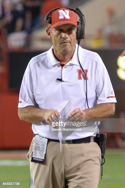 Head coach Mike Riley of the Nebraska Cornhuskers walks the sidelines during the game against the Arkansas State Red Wolves at Memorial Stadium on...