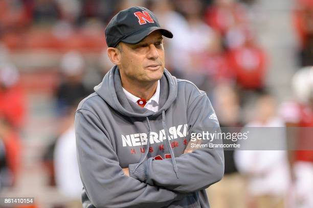 Head coach Mike Riley of the Nebraska Cornhuskers watches players warm up before the game against the Ohio State Buckeyes at Memorial Stadium on...