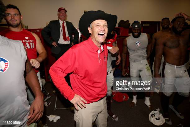 Head coach Mike Riley of the San Antonio Commanders celebrates in the locker room after beating the Arizona Hotshots 29-25 after the Alliance of...