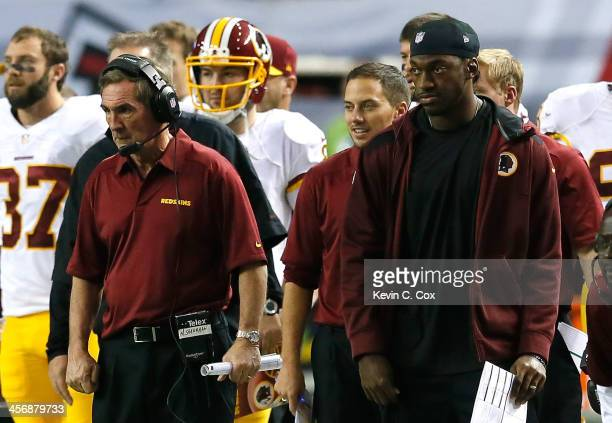 Head coach Mike Shanahan and Robert Griffin III of the Washington Redskins watch a field goal attempt in the final seconds of the first half against...