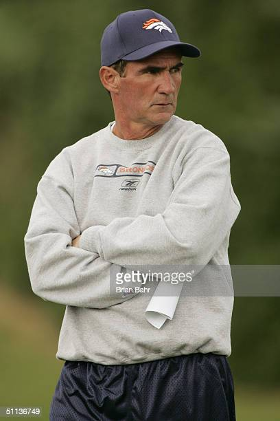 Head Coach Mike Shanahan of the Denver Broncos looks on during training camp at Dove Valley on July 28 2004 at Coors Field near Denver Colorado