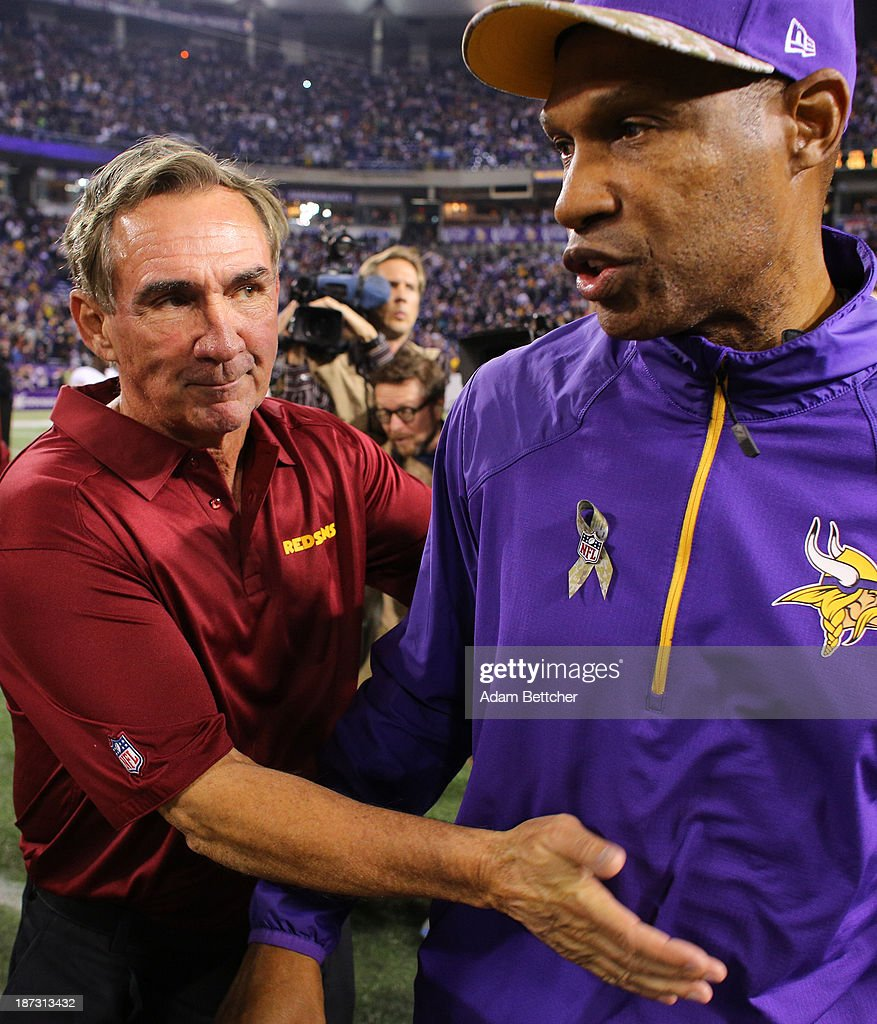 Head coach Mike Shanahan of the Washington Redskins and head coach Leslie Frazier of the Minnesota Vikings on November 7, 2013 at Mall of America Field at the Hubert Humphrey Metrodome in Minneapolis, Minnesota.