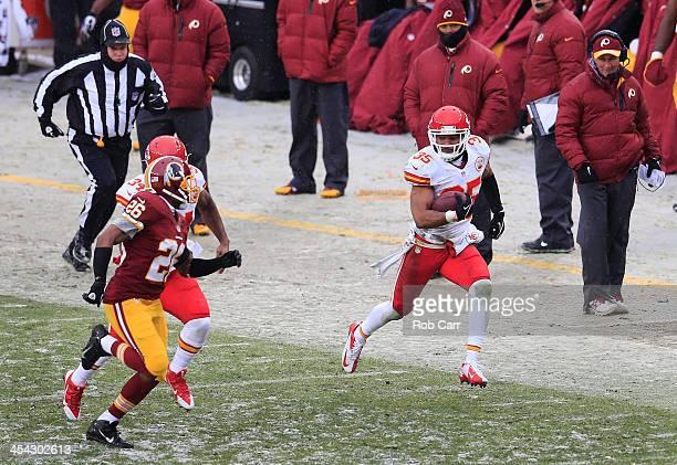 Head coach Mike Shanahan of the Washington Redskins looks on as Quintin Demps of the Kansas City Chiefs out runs Josh Wilson of the Washington...