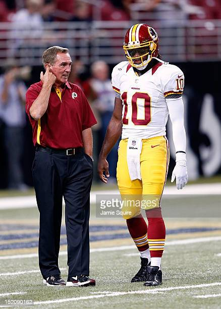 Head coach Mike Shanahan talks with quarterback Robert Griffin III of the Washington Redskins prior to the start of the game against the St Louis...