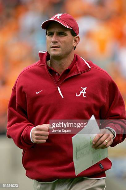 Head coach Mike Shula of the Alabama Crimson Tide runs onto the field prior to the game against Tennessee Volunteers at Neyland Stadium on October 23...