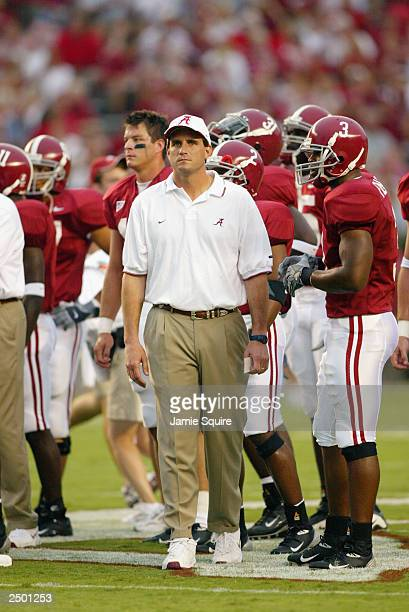Head coach Mike Shula of the Alabama Crimson Tide stands on the field with his players against the Oklahoma Sooners on September 6 2003 in Tuscaloosa...