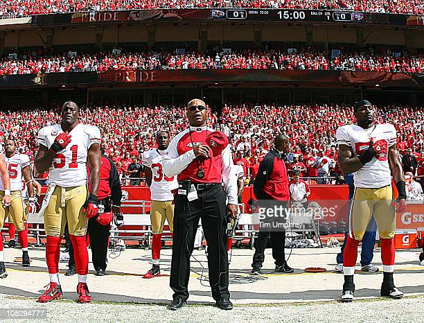 Head coach Mike Singletary and the San Francisco 49ers observe the national anthem before a game against the Kansas City Chiefs on September 26 2010...