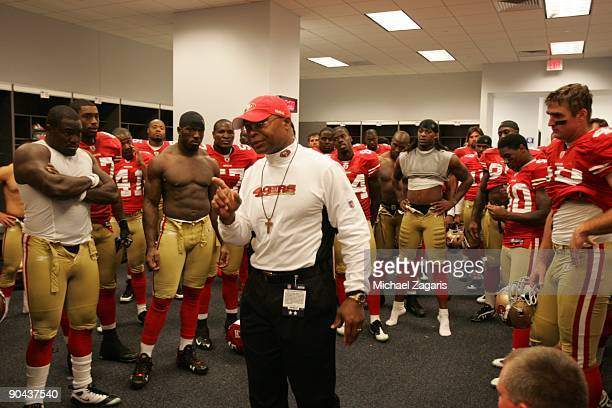 Head coach Mike Singletary of the San Francisco 49ers addresses the team in the locker room after the preseason game against the Dallas Cowboys at...
