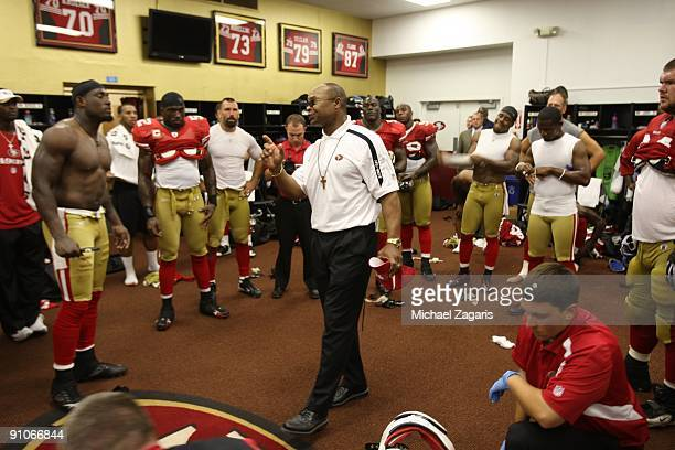 Head coach Mike Singletary of the San Francisco 49ers addresses the team in the locker room after the NFL game against the Seattle Seahawks at...