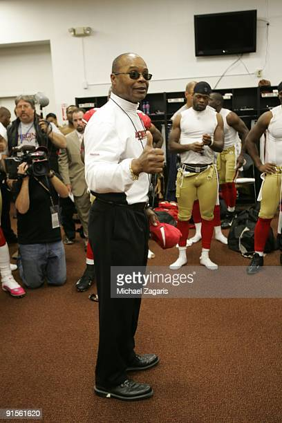 Head coach Mike Singletary of the San Francisco 49ers addresses the team in the locker room after the NFL game against the St Louis Rams at...