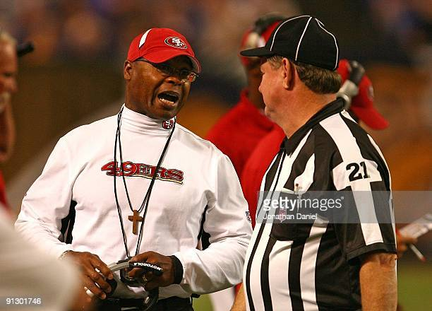 Head coach Mike Singletary of the San Francisco 49ers argues with Head Linesman John Schleyer during a game against the Minnesota Vikings at the...