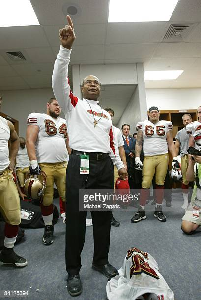 Head coach Mike Singletary of the San Francisco 49ers celebrates in the locker room after the NFL game against the St Louis Rams at the Edward Jones...