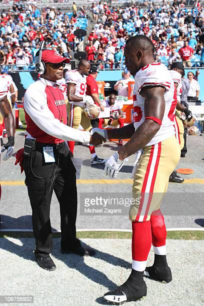 Head Coach Mike Singletary of the San Francisco 49ers shakes Vernon Davis hand prior to the game against the Carolina Panthers at Bank of America...