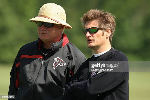 Head Coach Mike Smith and General Manager Thomas Dimitroff of the Atlanta Falcons watch play during mini camp at the Atlanta Flacons Training...