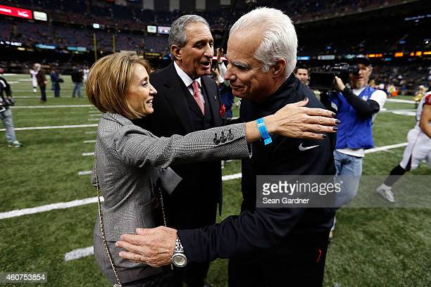 Head coach Mike Smith of the Atlanta Falcons greets Angela Macuga following a game against the New Orleans Saints at the MercedesBenz Superdome on...