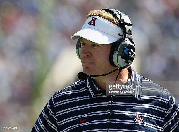 Head coach Mike Stoops of the Arizona Wildcats looks on during the college football game against the UCLA Bruins at the Rose Bowl on September 20...