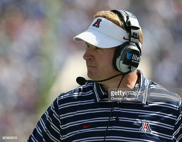 Head coach Mike Stoops of the Arizona Wildcats looks on during the college football game against the UCLA Bruins at the Rose Bowl on September 13...