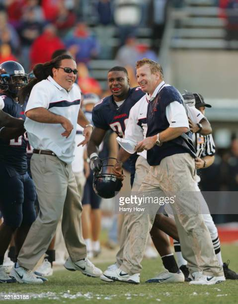 Head coach Mike Stoops of the Arizona Wildcats reacts after being drenched by the water cooler to celebrate the Wildcats victory over the Arizona...
