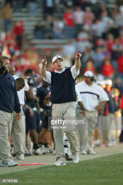 Head coach Mike Stoops of the Arizona Wildcats walks the sideline during the game against the Arizona State Sun Devils at Arizona Stadium on November...