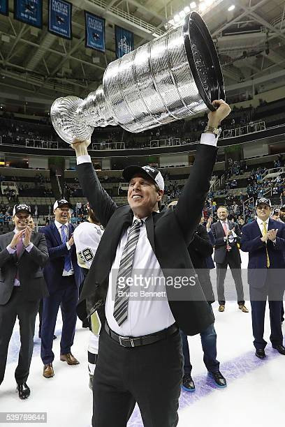 Head coach Mike Sullivan of the Pittsburgh Penguins celebrates by hoisting the Stanley Cup after their teams 31 victory to win the Stanley Cup...